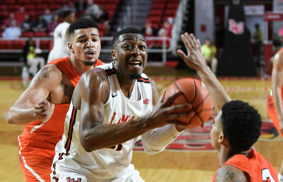 Lamar's Josh Nzeakor looks to take a shot while a couple of Sam Houston players defend during the first period of the game at the Montagne Center on Saturday. Photo taken on Saturday, 02/16/19. Ryan Welch/The Enterprise