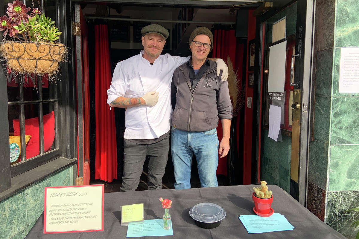 Senijad Felic, left, and Hasim Zecic, right, the owners of SF Grill in Noe Valley, are selling at-cost meals for $5.50 cash to help the community and especially seniors.
