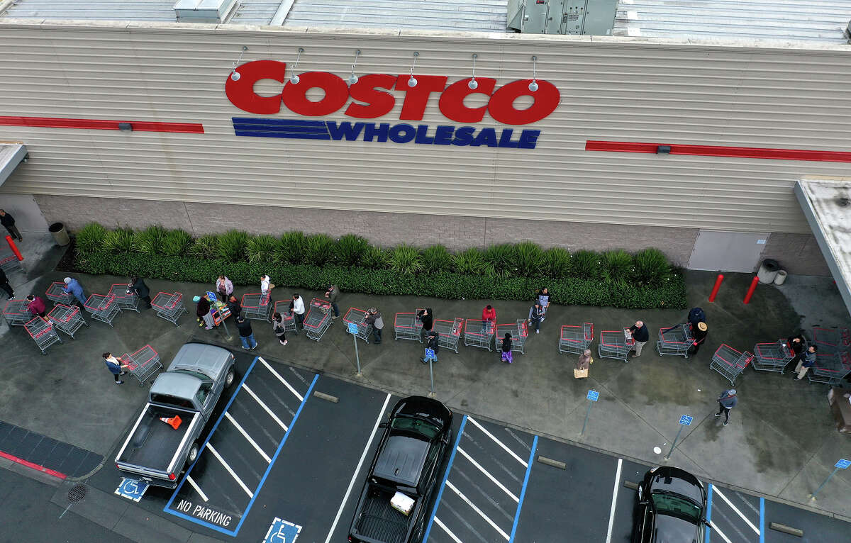 Hundreds of people line up to enter a Costco store on March 14, 2020 in Novato, California.
