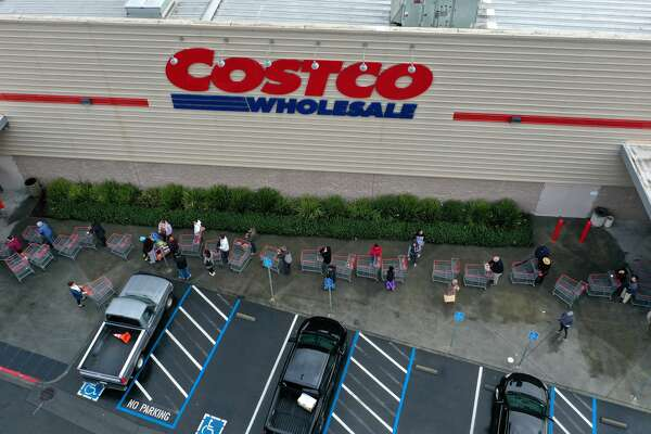 Hundreds of people line up to enter a Costco store on March 14, 2020 in Novato, California. Some Americans are stocking up on food, toilet paper, water and other items after the World Health Organization (WHO) declared Coronavirus (COVID-19) a pandemic. (Photo by Justin Sullivan/Getty Images)