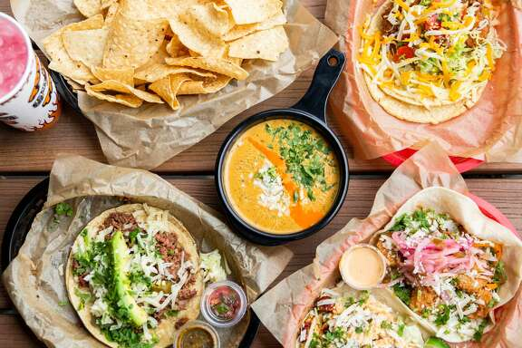 Assorted menu items at Torchy's Tacos.