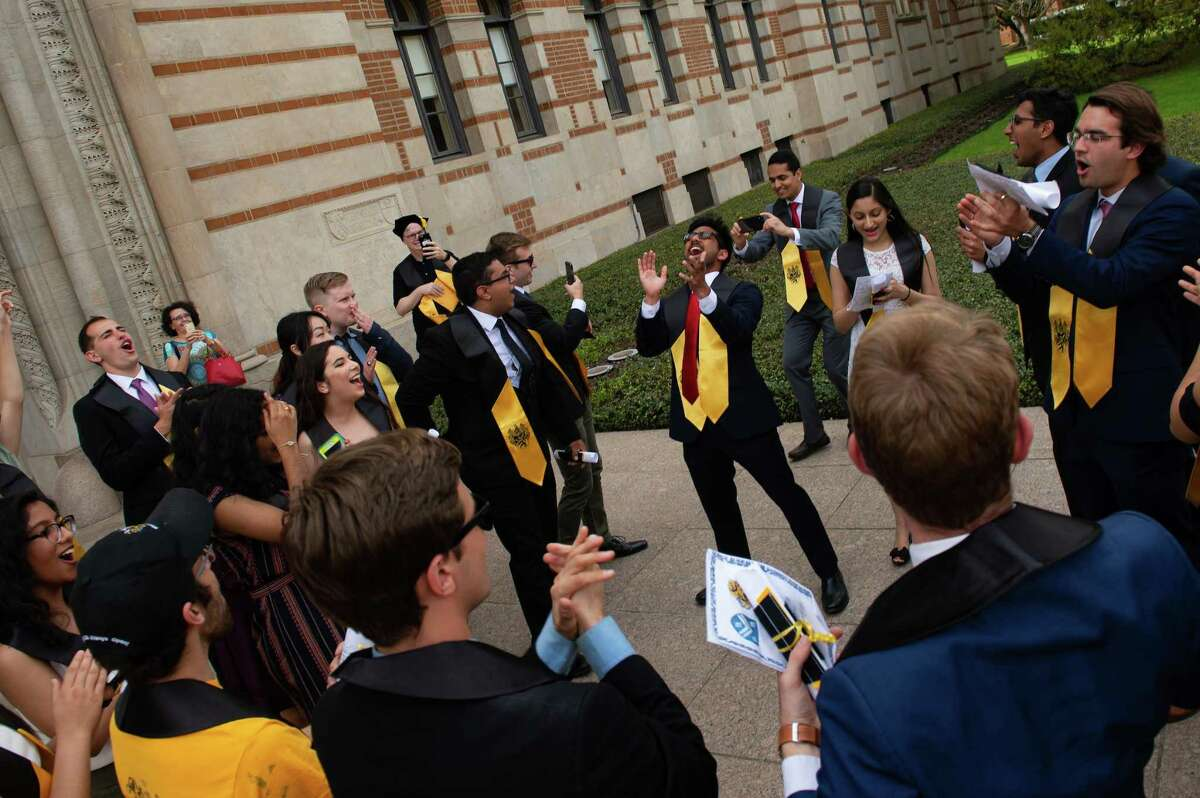 Within 24 hours of hearing that Rice University would close its campus and resume classes online for the rest of the semester, university students planned an impromptu graduation ceremony and led a celebratory procession through campus on March 13.