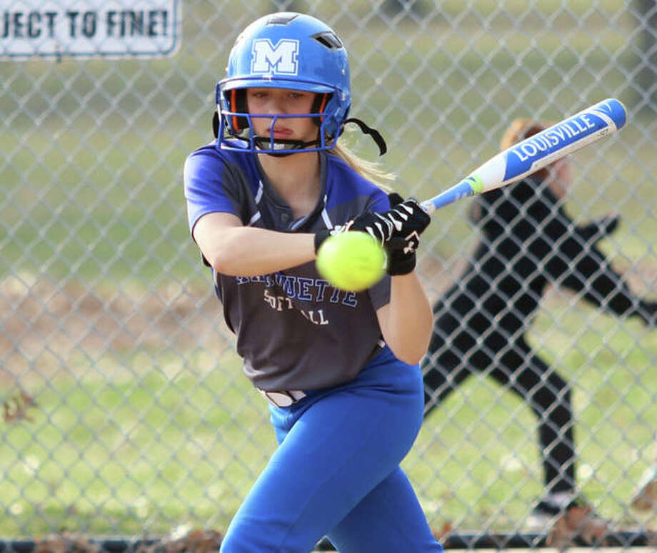 Marquette Catholic's Hayley Porter takes a pitch high for a ball during a game last season at Moore Park in Alton. Porter joins a deep list of returning starters from last season's 21-9 team. Photo: Greg Shashack / The Telegraph