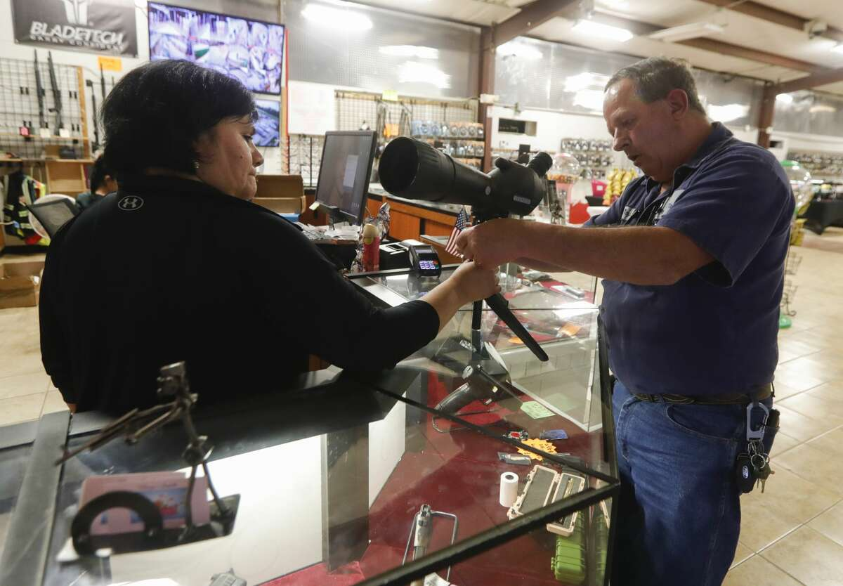 Allen Perry, owner of Mac Daddy?•s Cigars and Guns, talks about how the recent coronavirus outbreak has affected his ammo supply and gunsmithing business, Wednesday, March 18, 2020, in Conroe.