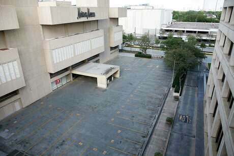 Empty parking lot outside of the Galleria in Houston on Wednesday, March 18, 2020.