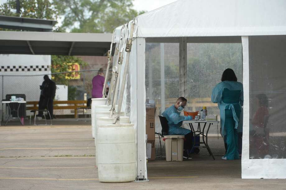 Medical personnel work inside a tent set up in the back lot of Legacy Community Health on N. Eleventh Street in Beaumont offering COVID-19 testing after screening and also doing flu testing. The clinic is the first private screening unit set up in Jefferson County. Photo taken Wednesday, March 18, 2020 Kim Brent/The Enterprise Photo: Kim Brent/The Enterprise
