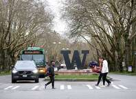 SEATTLE, WA - MARCH 06: Students at the University of Washington are on campus for the last day of in-person classes on March 6, 2020 in Seattle, Washington. The University will close starting Monday, March 9, as a precautionary reaction to the novel coronavirus, COVID-19, outbreak for the remainder of the winter quarter. (Photo by Karen Ducey/Getty Images)