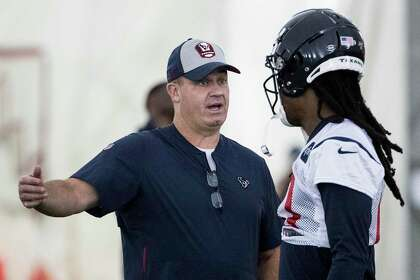 Bill O'Brien, left, will no longer be coaching DeAndre Hopkins after trading the star receiver to the Arizona Cardinals.