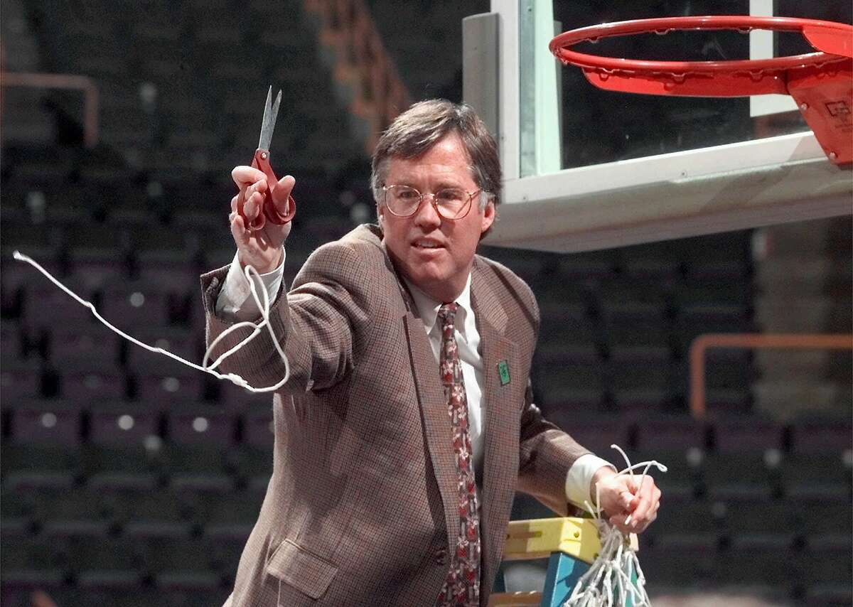 : Stanford head coach Mike Montgomery throws a piece of the net to players after his team beat Rhode Island 79-77 in the NCAA Midwest Regional final, Sunday, March 22, 1998, at the Kiel Center in St. Louis. The win clinched a trip to the Final Four in San Antonio. (AP Photo/Cliff Schiappa) Stanford head coach Mike Montgomery throws a piece of the net to players after his team beat Rhode Island 79-77 in the NCAA Midwest Regional final, Sunday, March 22, 1998, at the Kiel Center in St. Louis. The win clinched a trip to the Final Four in San Antonio. (AP Photo/Cliff Schiappa)