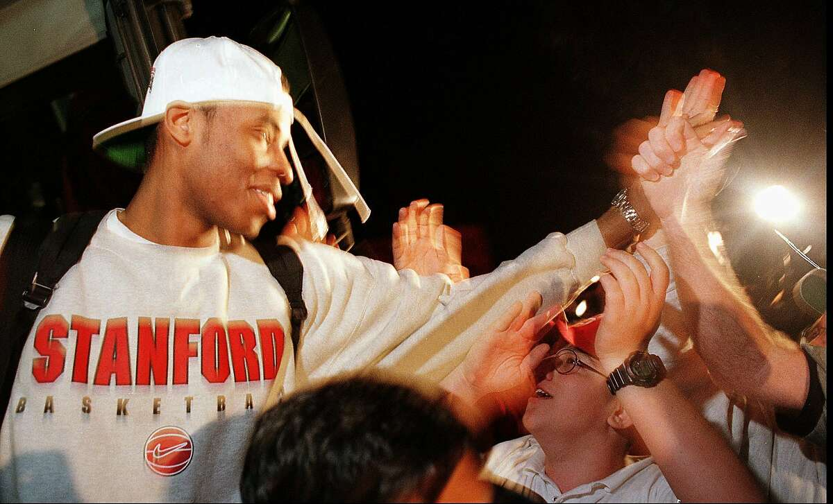 Stanford's Jaron Collins is greeted by cheering fans upon his team's late night arrival in Stanford, Calif., after they beat Rhode Island at the NCAA MIdwest Regional Final earlier in the day in St. Louis Sunday, March 22, 1998. Stanford's win places them in the Final Four compitition in San Antonio. (AP Photo/Thor Swift)