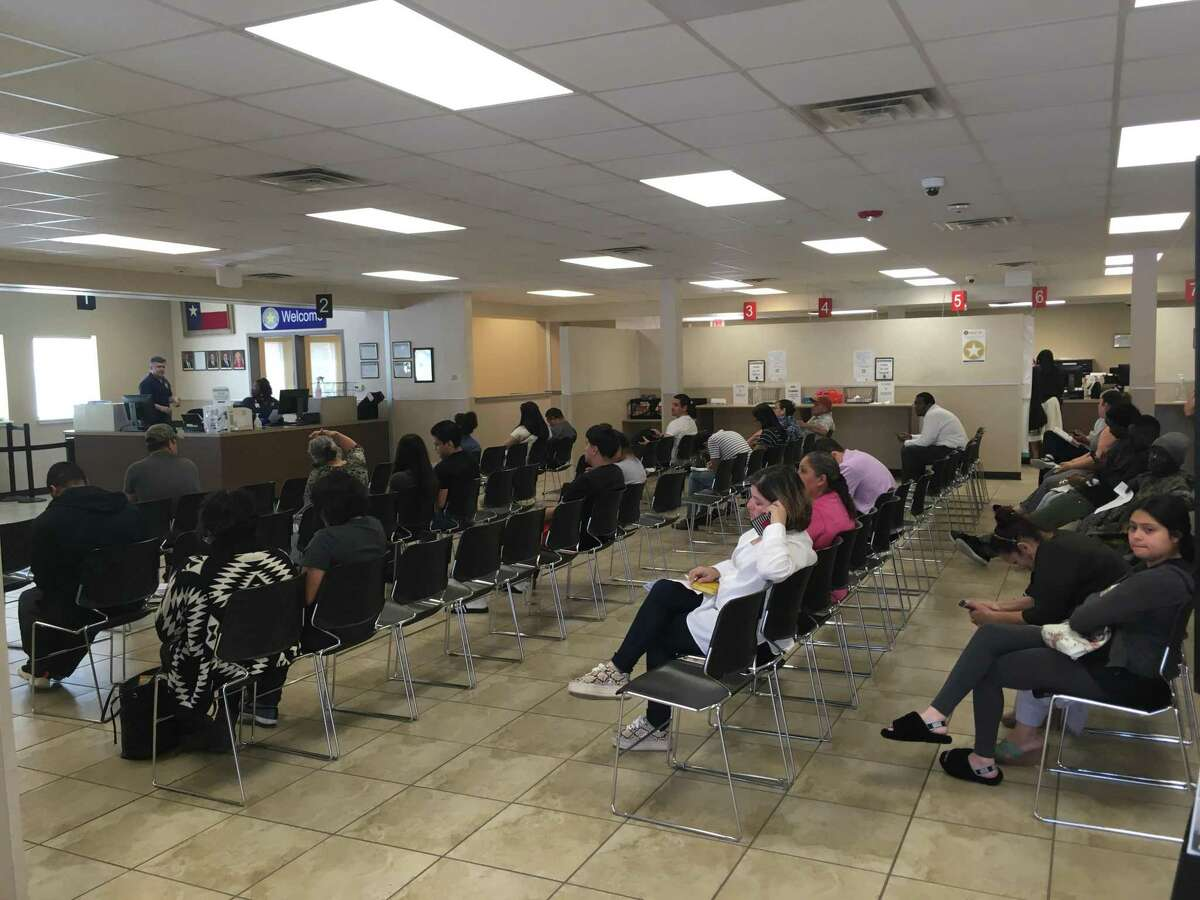 About 40 Houston-area residents wait for their numbers to be called at a DPS office on the northwest side of town on Wednesday. Even as Gov. Greg Abbott temporarily lifted license renewal requirements as the country faces a pandemic, the agency's offices remained open and drew crowds.
