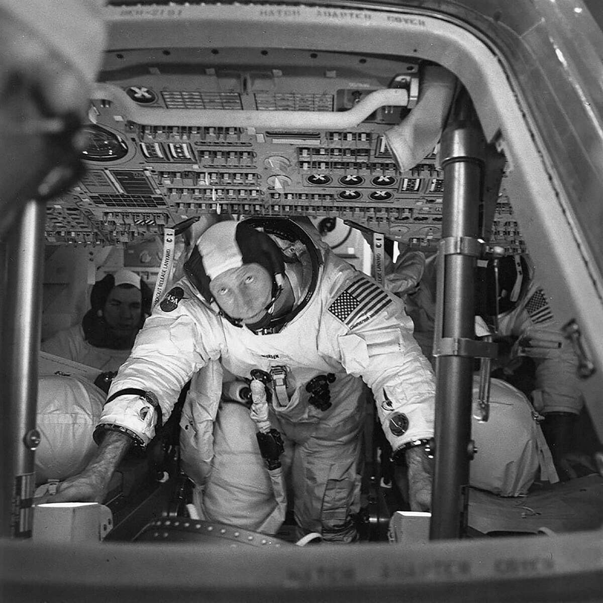 In an image provided by NASA, Alfred M. Worden, center, with his fellow astronauts Col. David R. Scott, left, and Lt. Col. James B. Irwin in the space capsule Endeavor during a test in Cape Canaveral, Fla., March 26, 1971. Worden, who orbited the moon in the summer of 1971, taking sophisticated photographs of the lunar terrain while his fellow astronauts of the Apollo 15 mission roamed its surface in a newly developed four-wheel rover, died in Houston, his family announced on Wednesday, March 18, 2020, on Twitter. He was 88.