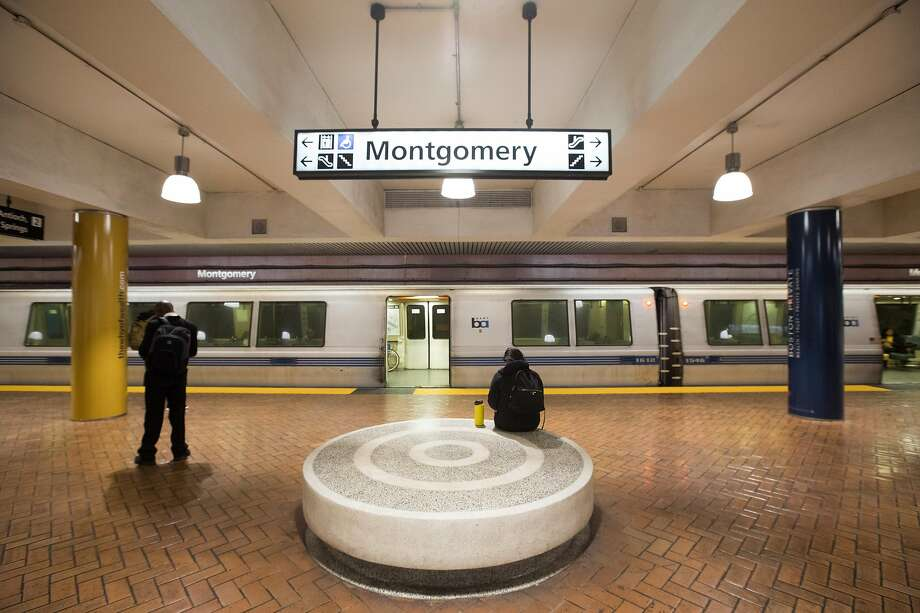 Passengers wait for a BART train during the evening commute. San Francisco had its first shelter-in-place day on March 17th, 2020 in response to the spread of the COVID-19 coronavirus. Photo: Douglas Zimmerman / SFGate