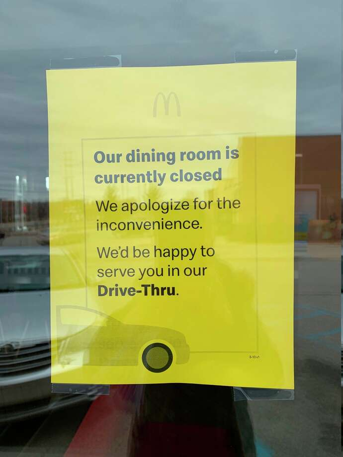 A sign posted on the door at McDonald's Monday reminded customers that service was only available at the drive-through after Governor Gretchen Whitmer closed all restaurants and bars to the public. (Herald Review photo/Cathie Crew)