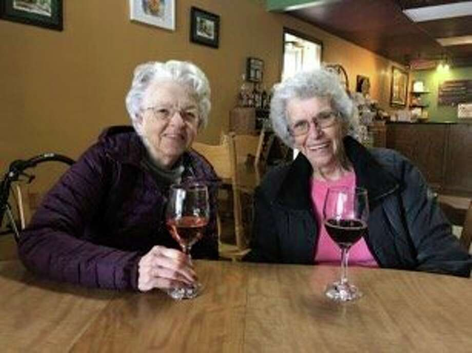 Primrose Residents enjoy a glass of wine at Grape Beginnings Winery. (Photo provided)