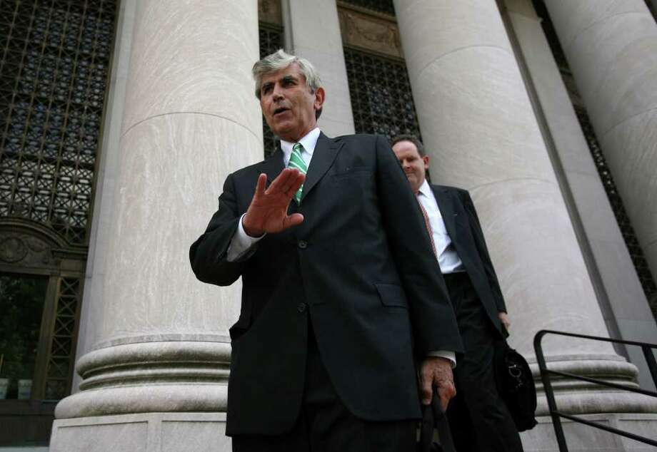 Defense attorneys for Douglas Perlitz, William F. Dow III and David Grudberg leave the Federal court in New Haven Conn. on Wednesday August 18, 2010. Douglas Perlitz pleaded guilty to one charge involving the sexual abuse of a minor boy. Perlitz will be sentenced on Dec. 21. Photo: Brian A. Pounds / Connecticut Post