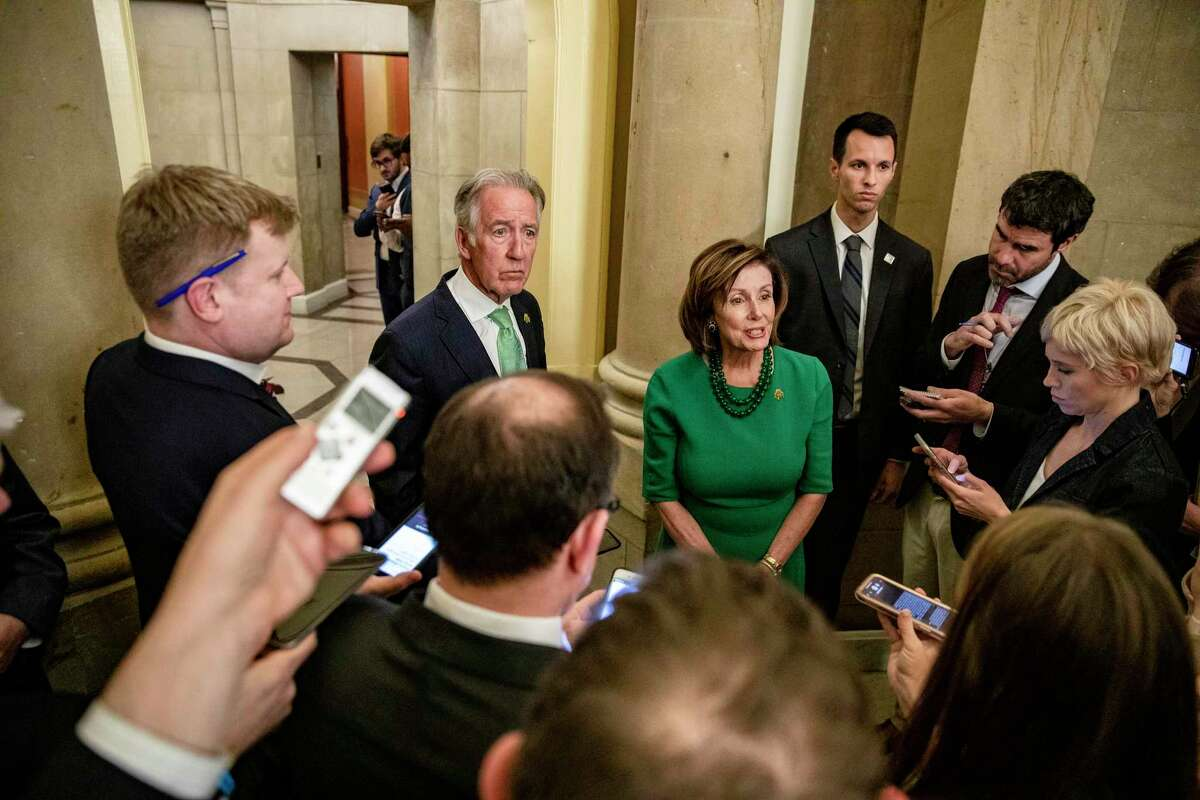 """House Speaker Nancy Pelosi (D-Calif.), joined by Rep. Richard Neal (D-Mass.), chairman of the House Ways and Means Committee, speaks to reporters following negations over the emergency relief package """"Families First Coronavirus Response Act,"""" in Washington on Thursday, March 12, 2020.(Samuel Corum/The New York Times)"""