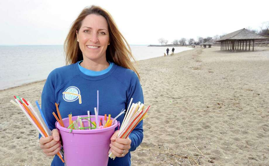 Julie DesChamps is co-founder of Skip the Straw, a movement in Greenwich to ban straws. DesChamps is photograph on Friday, Feb. 22, 2019 with a collection of plastic straws she has collected at Greenwich Point in Greenwiich, Connecticut. The group is preparing for a beach cleanup on March 3. Photo: Matthew Brown / Hearst Connecticut Media / Stamford Advocate