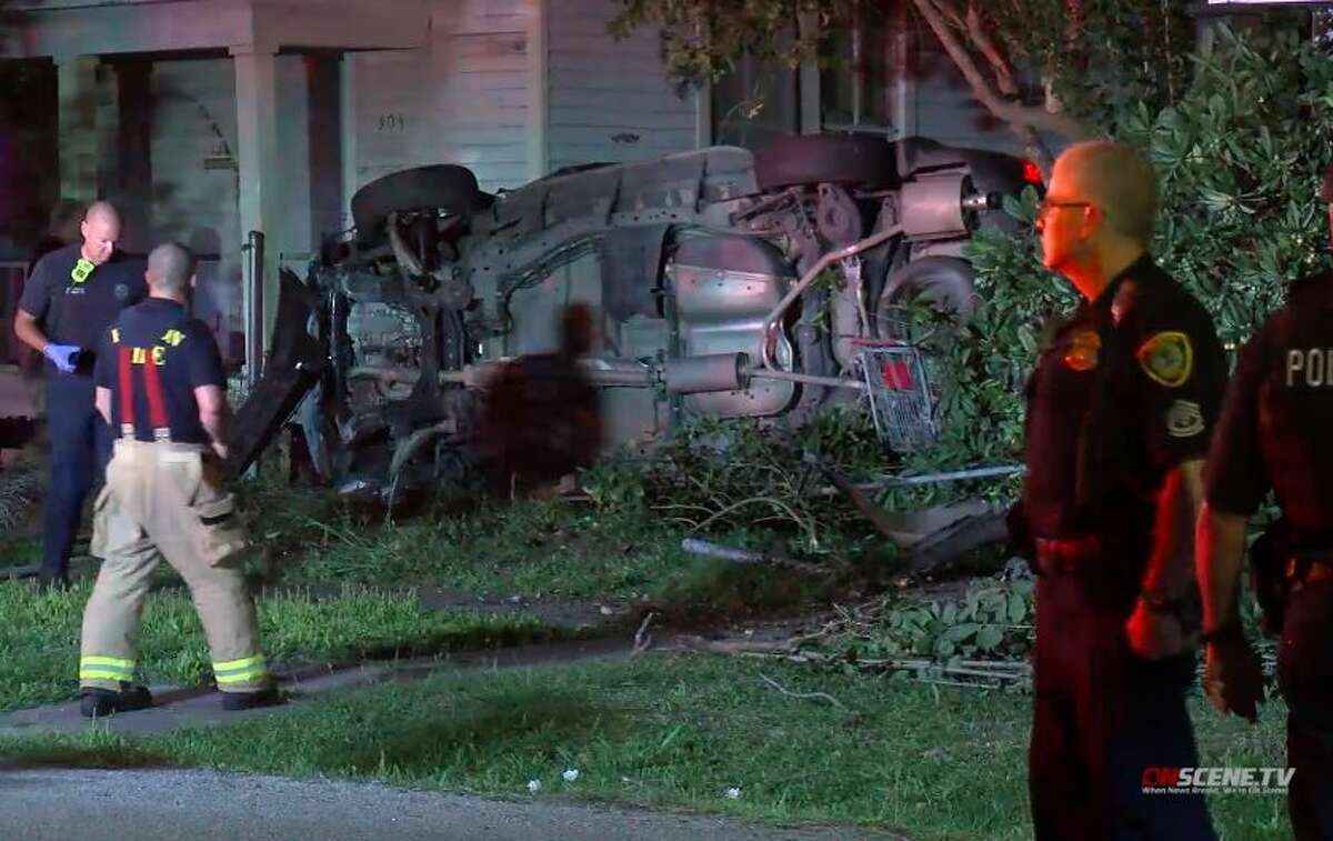 Two people were taken into custody after a police chase in Houston that ended when a car flipped on its side and came to a rest between two houses on Thursday, March 19, 2020.