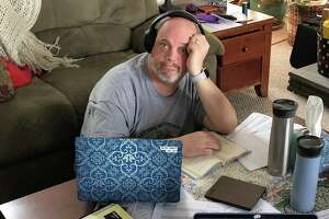 Middle school teacher Robert Walsh works from his home on Wednesday.