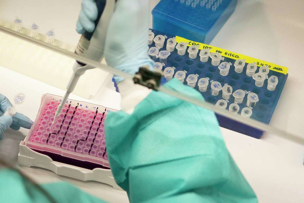 Erica Tam, medical technologist in the molecular microbiology lab, adds the RNA extracted from patient samples collected at the hospital to the test she is running to detect COVID-19 using reagents from a CDC provided test kit, Thursday, March 12, 2020, at Texas Children's Hospital in Houston.