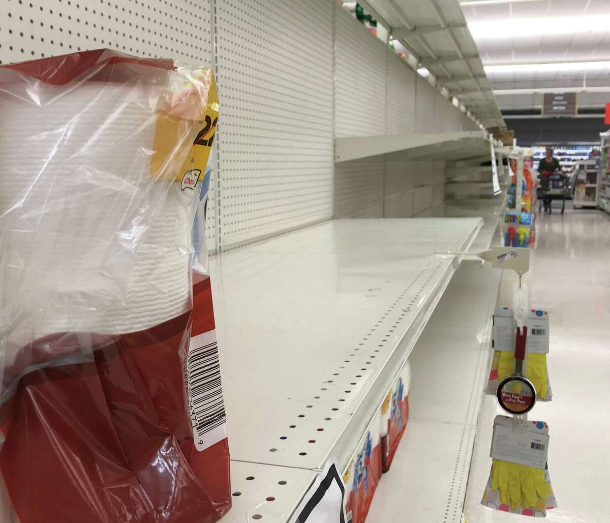 A few remaining packages of paper towels were quickly scooped up early Wednesday afternoon, March 18, 2020 at the Stop & Shop in the Ridgeway shopping center between Bedford and Summer streets in Stamford, but rolls of toilet paper were nowhere to be found. Toilet paper has been virtually gone from shelves citywide since shoppers began stocking up in response to the coronavirus outbreak.