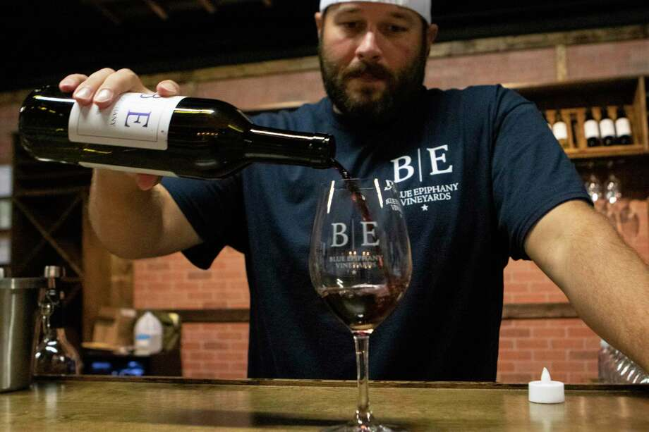 """Blue Epiphany Vineyards co-owner Chris Dowell pours a glass of """"House Diveded,"""" one of several wines made by Blue Epiphany Vineyards in 2018 at Blue Epiphany Vineyards in Conroe. Blue Epiphany Vineyards is a part of the new Sam Houston Wine Trail. Photo: Cody Bahn, Houston Chronicle / Staff Photographer / © 2018 Houston Chronicle"""