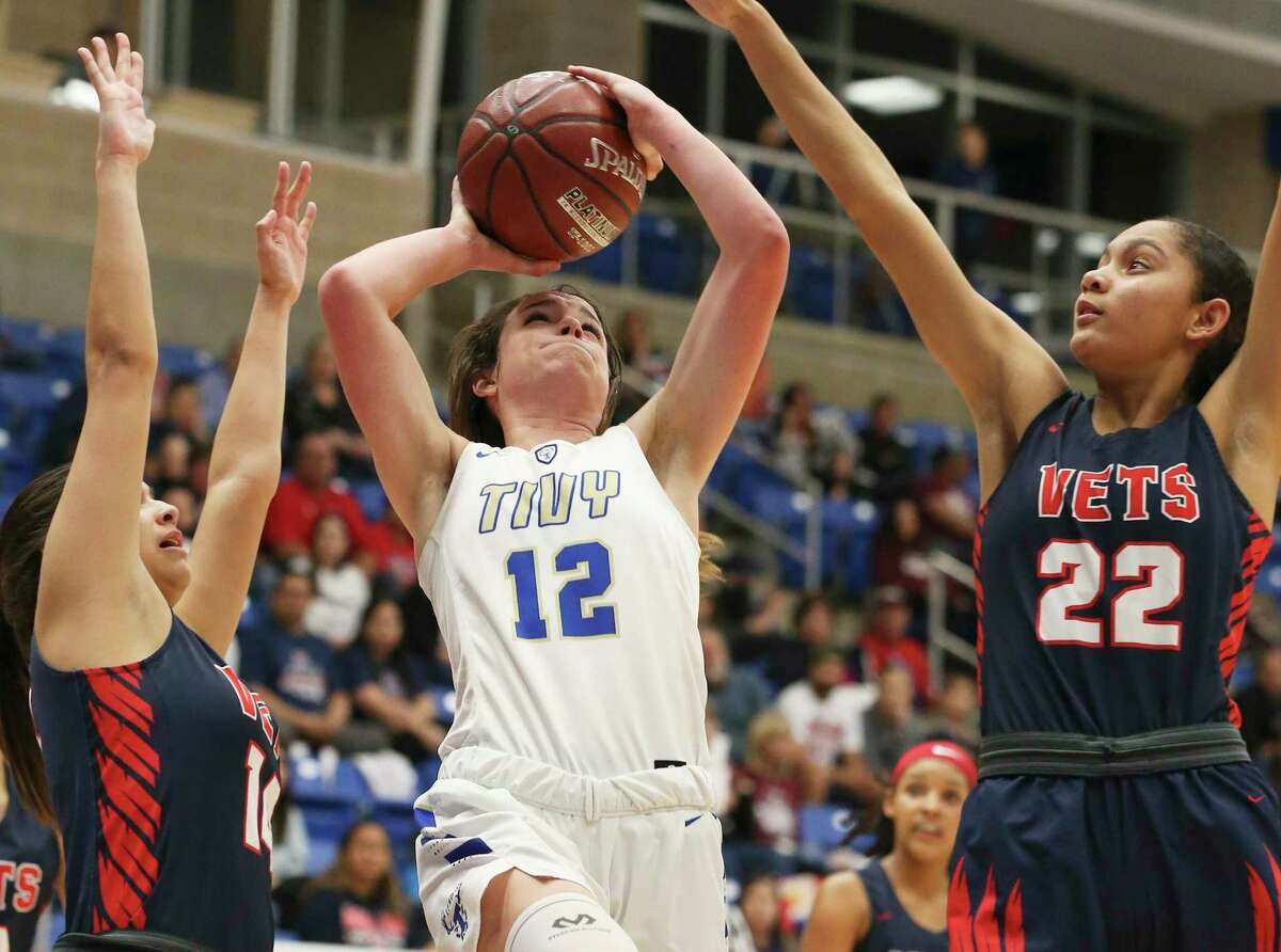 Kerrville Tivy's Audrey Robertson (12) attempts a shot against Corpus Christi Veterans Memorial's Samantha Perez (14) and Tatiana Mosley (22) during their Region IV-5A semifinal game on Friday, Feb. 28, 2020. Tiny defeated CC Veterans Memorial, 59-55, to advance to the regional final.