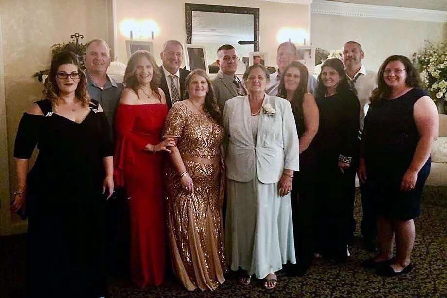 An undated family photo shows Grace Fusco, center, and her 11 children. Fusco, 73, died on Wednesday night, March 18, 2020, after contracting the coronavirus — hours after her son died from the virus and five days after her daughter's death, a relative said. (Courtesy of The Fusco Family via The New York Times)   -- NO SALES; FOR EDITORIAL USE ONLY WITH NYT STORY SLUGGED NJ-VIRUS BY TRACEY TULLY FOR MARCH 19, 2020. ALL OTHER USE PROHIBITED. -- Photo: The Fusco Family, NYT