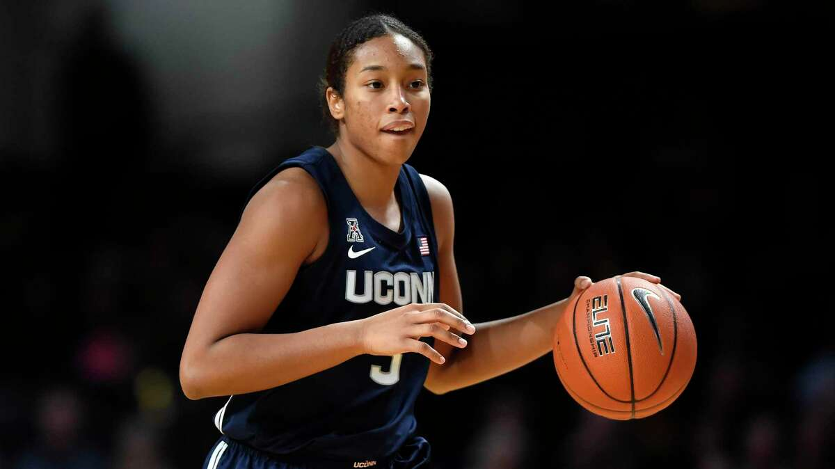 FILE - In this Nov. 13, 2019, file photo, Connecticut forward Megan Walker (3) plays against Vanderbilt during the second half of an NCAA college basketball game in Nashville, Tenn. Walker was selected to The Associated Press women's All-America first team, Thursday, March 19, 2020. (AP Photo/Mark Zaleski, File)