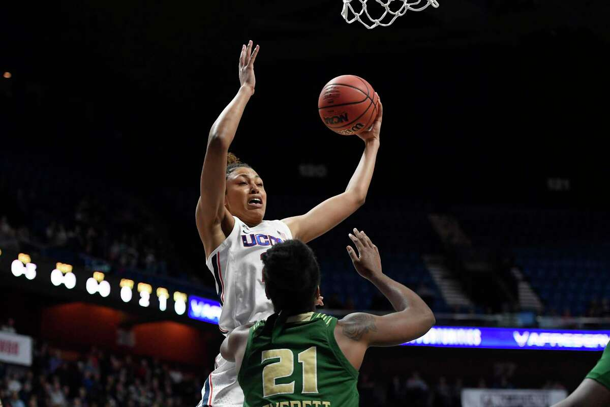UConn's Olivia Nelson-Ododa grabs a rebound over South Florida's Shae Leverett during the first half of the AAC tournament semifinals at Mohegan Sun Arena earlier this month.