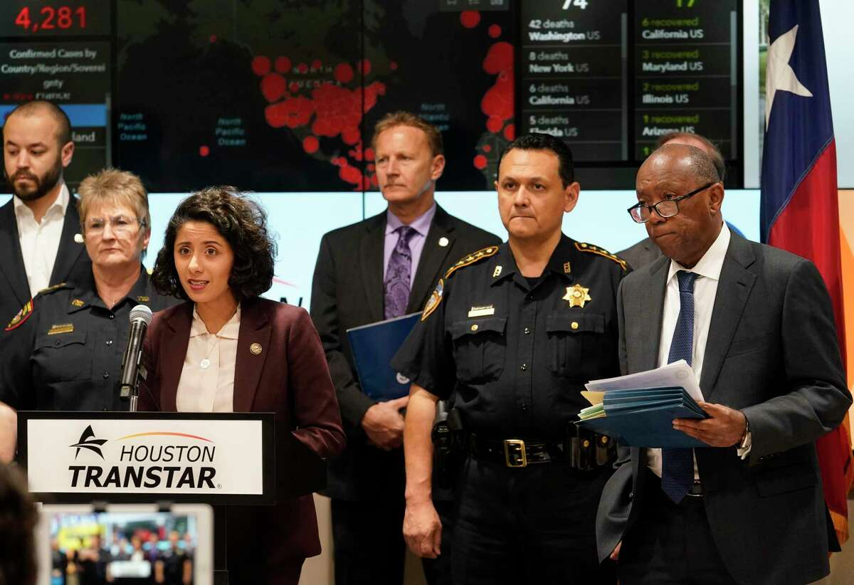 Harris County Judge Lina Hidalgo, left, Harris County Sheriff Ed Gonzalez, and Houston Mayor Sylvester Turner, right, with others hold a COVID-19 news conference at Houston TranStar, 6922 Katy Road, Monday, March 16, 2020, in Houston.