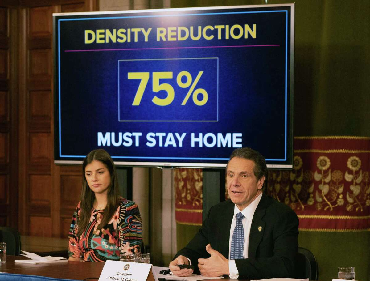 Gov. Andrew Cuomo holds a daily coronavirus news briefing with his daughter Michaela, left, on Thursday, March 19, 2020, in the Red Room at the Capitol in Albany, N.Y. (Office of the Governor)
