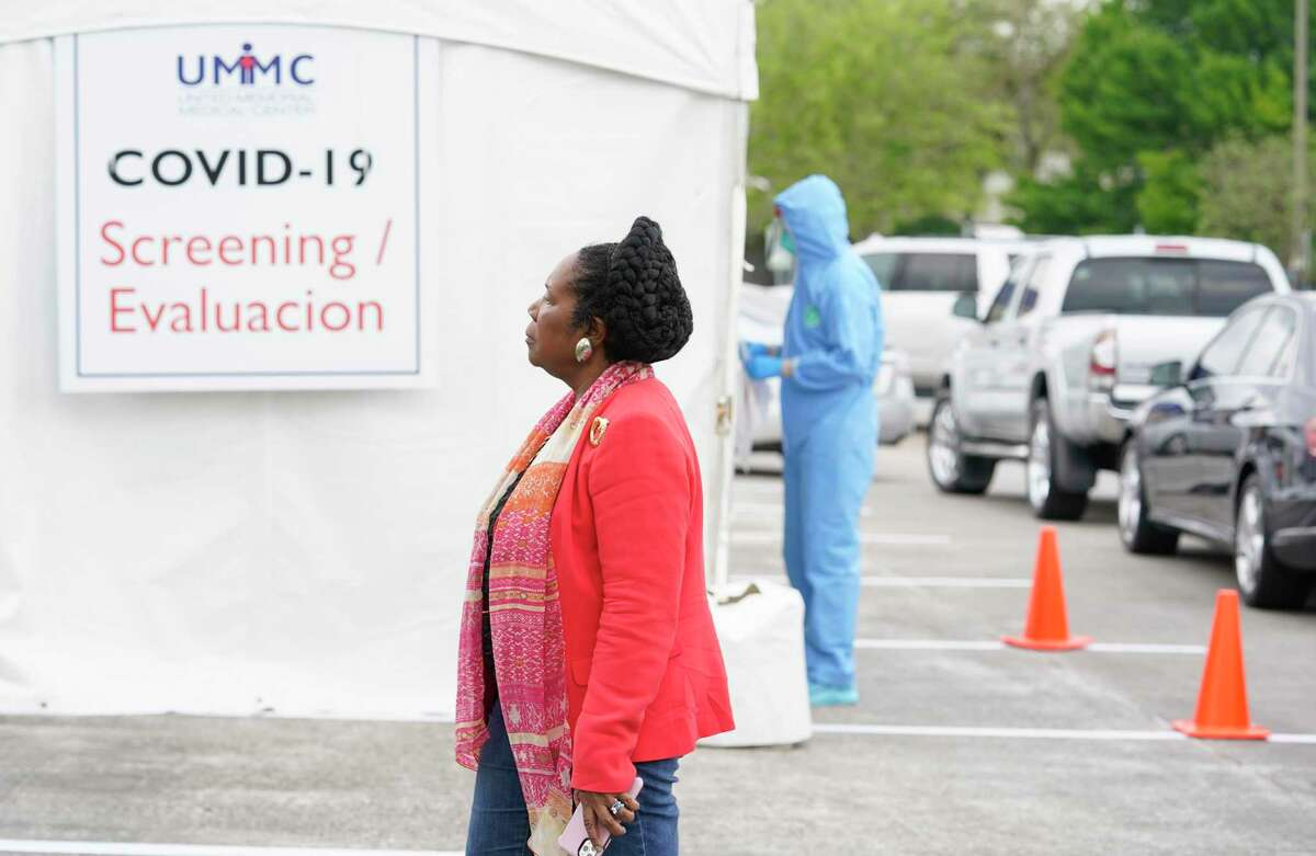 Congresswoman Sheila Jackson Lee, Chair of the Congressional Coronavirus Task Force, watches as workers evaluation people at the first stop at a coronavirus drive-thru testing area United Methodist Medical Center, 510 West Tidwell, Thursday, March 19, 2020 in Houston. The Congresswoman held a media conference at the center to urge residents with symptoms of the coronavirus to take free testing.