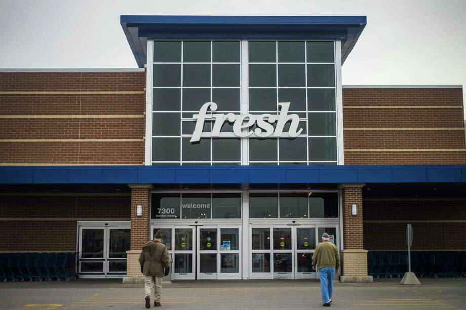 Customers walk towards the entrance of Meijer Thursday, March 19, 2020 in Midland. (Katy Kildee/kkildee@mdn.net)