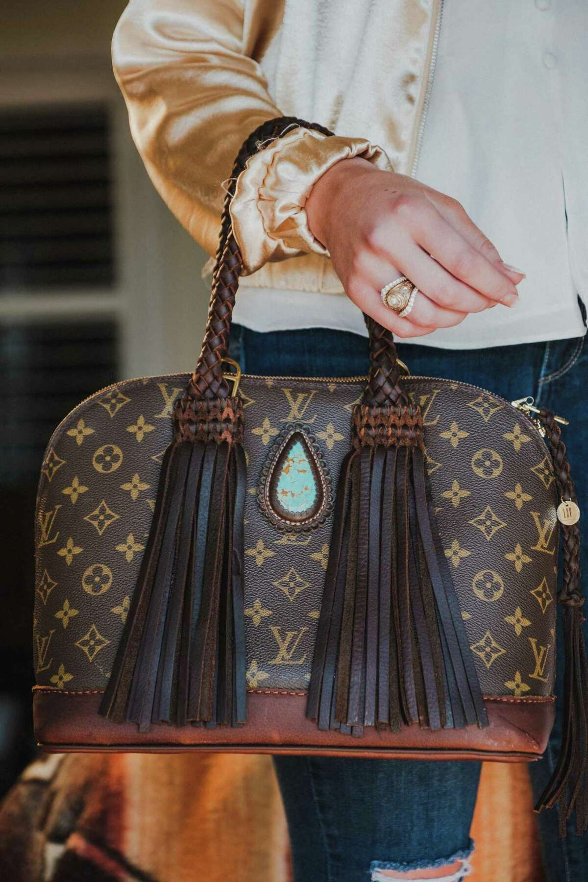 Kay McMurtre usually takes 40 enhanced Louis Vuitton bags to the antiques shows at Marburger Farm and Zapp Hall. They range in cost from $1,250 to $6,000.