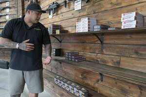 Alex Tablazon, assistant manager at SK Arms, talks about the low inventory they and others are dealing with 03/19/2020. Tablazon said they are completely out of common caliber ammunition and distributers are low or delayed in filling orders for new stock. Tim Fischer/Reporter-Telegram