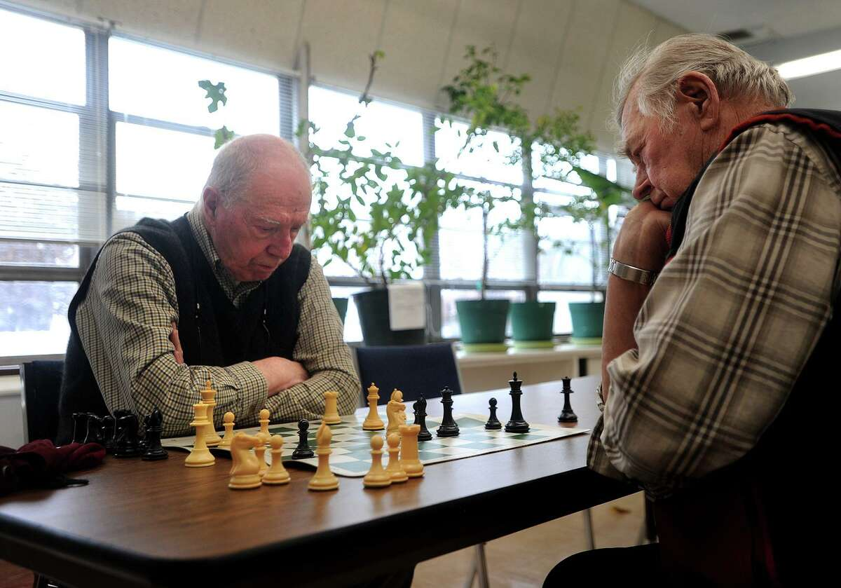 Frank DeStefano, left, of Fairfield, and Teo Perrini, of Shelton, play a game of chess as part of the Fairfield Senior Chess Club at the Bigelow Center for Senior Activities in 2018