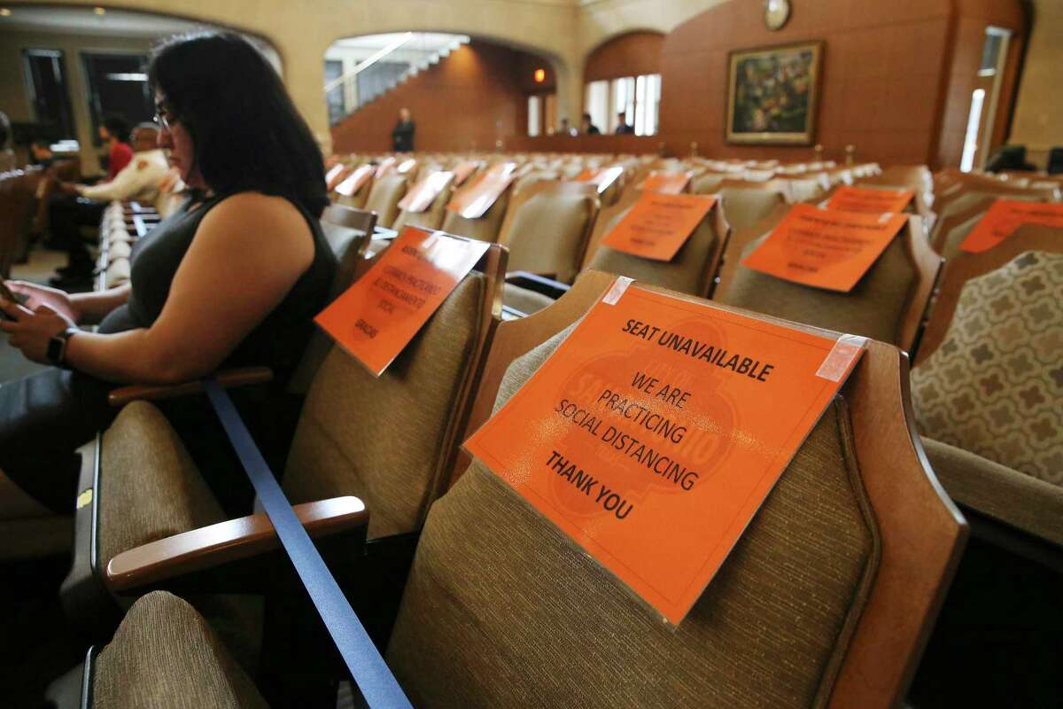 Signage is placed on chairs to observe social distancing during a meeting by Mayor Ron Nirenberg and the City Council as they discuss extending the latest coronavirus emergency declaration to 30 days on Thursday, March 19, 2020. Council members approved the measure by a unanimous vote.