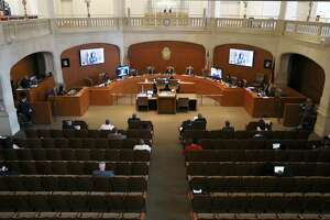 The view from above shows the efforts to maintain social distance in City Council chambers as Mayor Ron Nirenberg and the City Council gather on Mar. 19. The same scenario took place Thursday as the council voted in favor of the stay-at-home order signed by the mayor, exending it to April 9.
