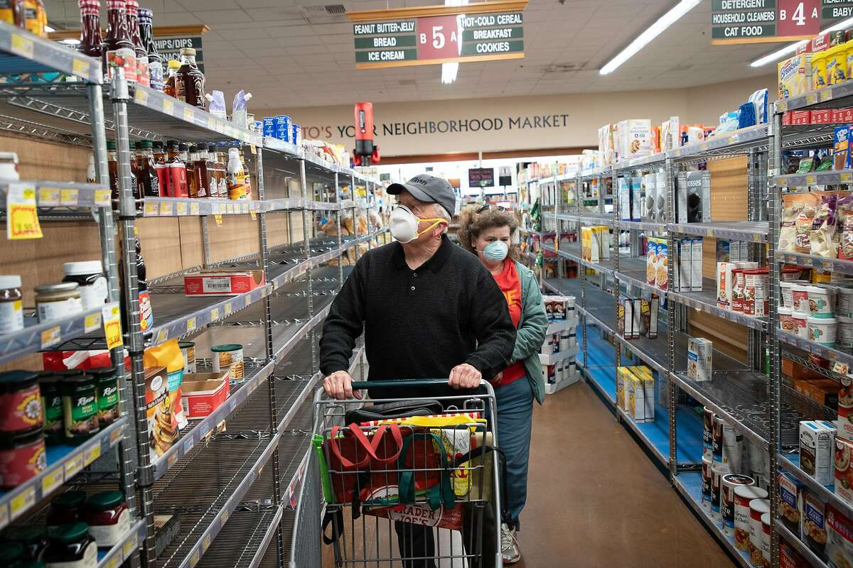 The bread isle was a bit depleted as Robert Cushing, 78, of San Jose, and his daughter, Michele Cushing, shop at Zanotto's Willow Glen Market Thursday, March 19, 2020, in San Jose, Calif. The store is open only to seniors from 8 - 9 a.m.