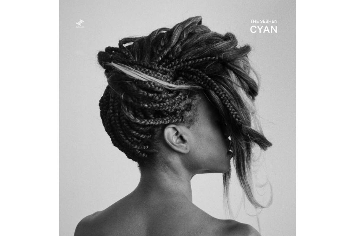 """The Seshen """"Cyan"""" The LP builds upon the progression that has been made since 2016's 'Flames and Figures'. It is a body of music that is as personal as it is political, as soft as it is strong and as joyful as it is angry. Anchored by Lalin St. Juste's sly, silvery vocals and cerebral yet playful rhythms from producer-bassist Akiyoshi Ehara, The Seshen's music pulls from a deep well of electronic influences, R&B, and indie rock. - Courtesy of Bandcamp"""