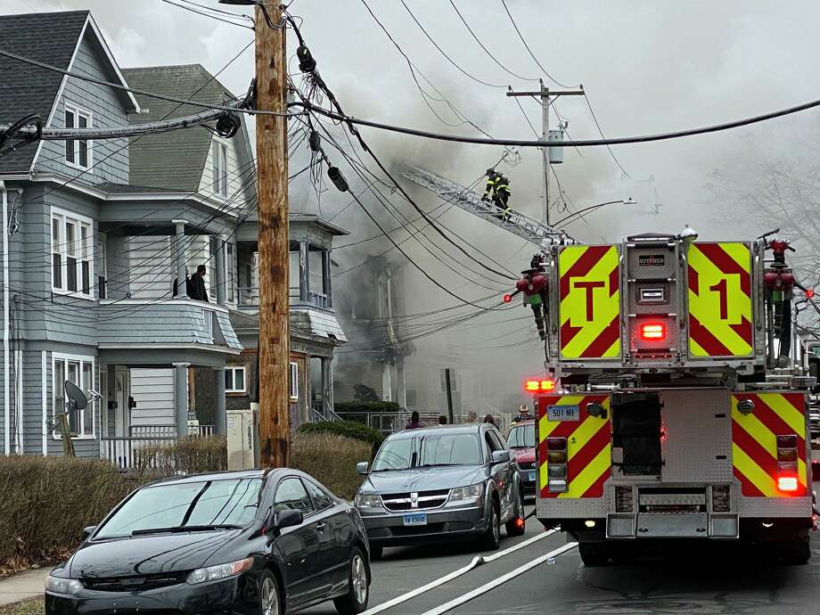 New Haven firefighters responded to a two-alarm fire on Mead Street Thursday. Photo: New Haven Fire Twitter /