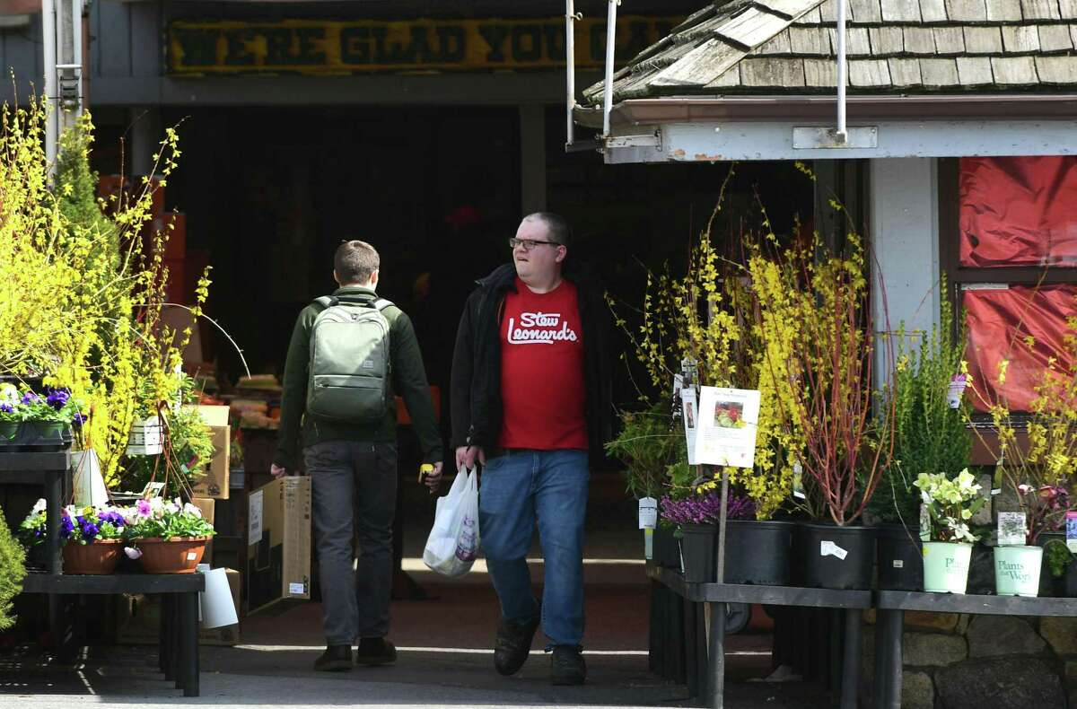 Shoppers head in and out of Stew Leonard's in Norwalk on Wednesday.