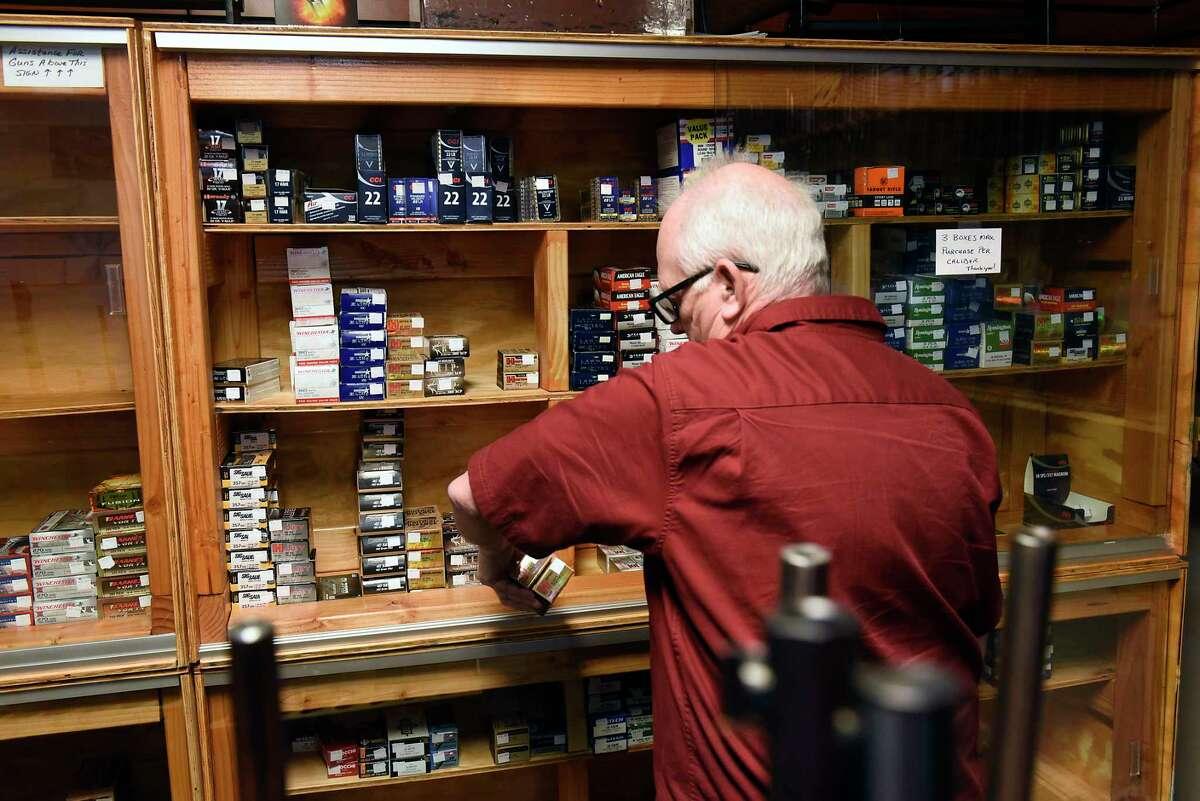 Employee Jim Retajczyk retrieves ammunition for a customer at Upstate Guns & Ammo store on Thursday, March 19, 2020 in SSchenectady N.Y. (Lori Van Buren/Times Union)