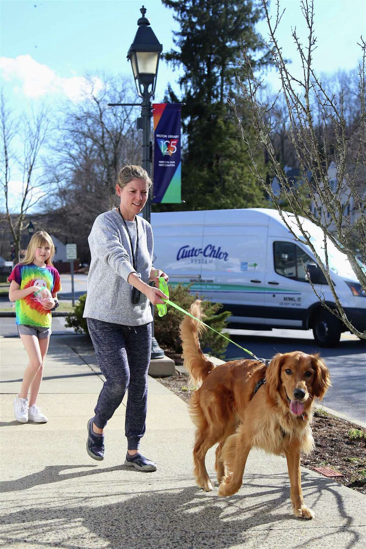 Juliet Craig of Wilton takes a short walk around the village with her daughter Natalie, 11, and their dog Chewie.