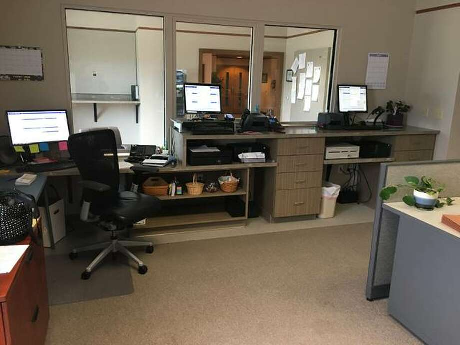 This new partition glass separates the utility and billing clerks from customers in Glen Carbon's revamped administration office. Formerly, there was a small, hinged door on the left that provided employee access.  Photo: Courtesy Of Village Of Glen Carbon