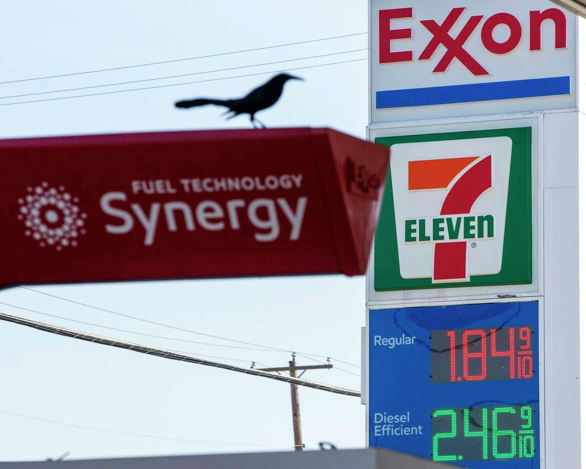 Signs advertise low fuel gas prices at an Exxon gas station in Dallas this month. The company advertises its efforts to find alternative fuels, but continues to spend huge amounts extracting fossil fuels.