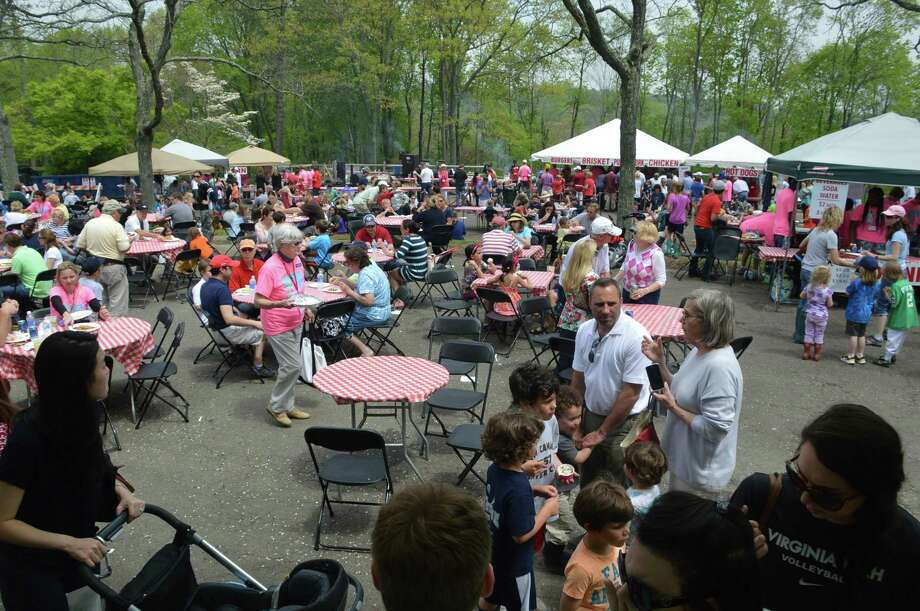 Thousands of people partook in the variety of food offerings at the 65th annual May Fair at St. Mark's Episcopal Church in New Canaan, Connecticut, on Saturday, May 10, 2019. St. Mark's has canceled this year's May Fair, which was scheduled for Friday, May 8, 2020, and Saturday, May 9, 2020, due to the coronavirus crisis. Photo: Jarret Liotta / For Hearst Connecticut Media / New Canaan News Contributed