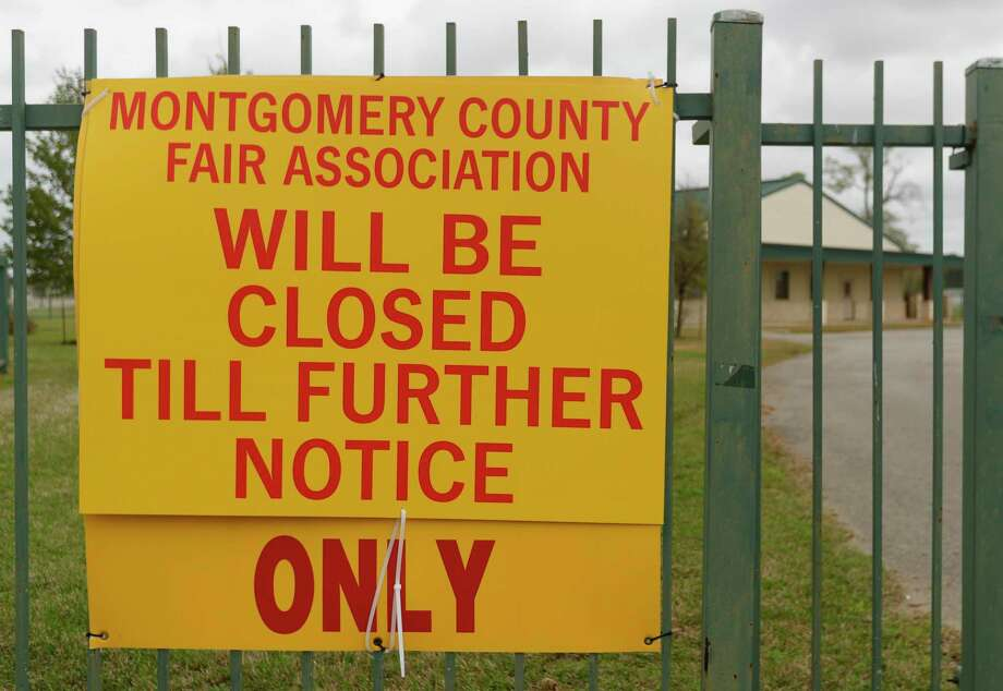 A sign notifies visitors the Montgomery County Fair Association office is closed, Saturday, March 14, 2020, in Conroe. Some residents who had planned to work the fair this year are now calling the CAC in need of assistance. Photo: Jason Fochtman, Houston Chronicle / Staff Photographer / Houston Chronicle  © 2020